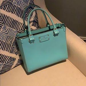 Light blue Kate Spade bag.